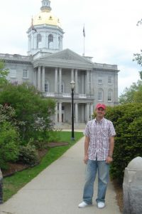 "In front of the New Hampshire State House in Concord, proud of its status as ""the nation's oldest State House in which the legislature still occupies its original chambers"", per an insciption carved into the stone in 1969 for its 150th anniversary.  This designation still stands today as its bicentennial anniversary quickly approaches."