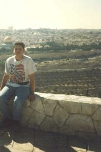 The Mount of Olives provides this panoramic viewpoint looking east to the Old City of Jerusalem across the Kidron Valley.  One of Jerusalem's most iconic sights, the Dome of the Rock is visible in the background.  No, the background -- behind me!   On the left!  See it?  Ignore the fanny pack and focus!!