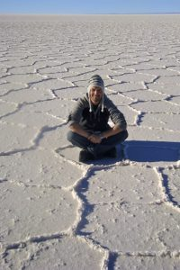 Yes, I'm freezing cold out here, wearing my new Peruvian alpaca beanie and sweater, but no -- this is not snow.  This is Bolivia's Salar de Uyuni, the largest expanse of salt on earth, covering more than 10,000 square kilometers.  It's an eerily beautiful place, and well worth the trek out into the Bolivian Altiplano!