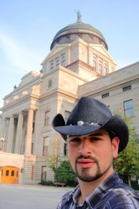 "Just another cowboy taking a selfie at the elegant Greek-neoclassical style State Capitol building in Helena, Montana.  I gradually amassed quite a collection of cowboy hats, belts and boots thanks to my various road trips ""Exploring America""."