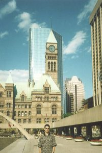 Toronto's Romanesque Revival style Old City Hall, a heritage landmark built in 1899, provides for an interesting juxtaposition with the modern glass-clad Cadillac Fairview Tower behind.  Both buildings are seen from Nathan Phillips Square, one of Toronto's most popular public spaces.