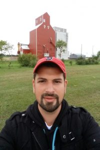 """The """"Skyscrapers of the Prairie"""", these wooden grain elevators can be spotted from miles away across the flat, open prairie.  Once as numerous as the small farming towns they towered over, most have now been replaced by less-fire-prone concrete or steel ones.  Any still standing tall, like this one in Davidson, Manitoba, are now rare historical treasures and quintessential examples of traditional prairie architecture."""